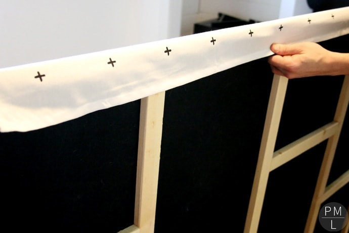 This DIY Sliding Fabric Door is a great idea if you want to save money on a barn door!